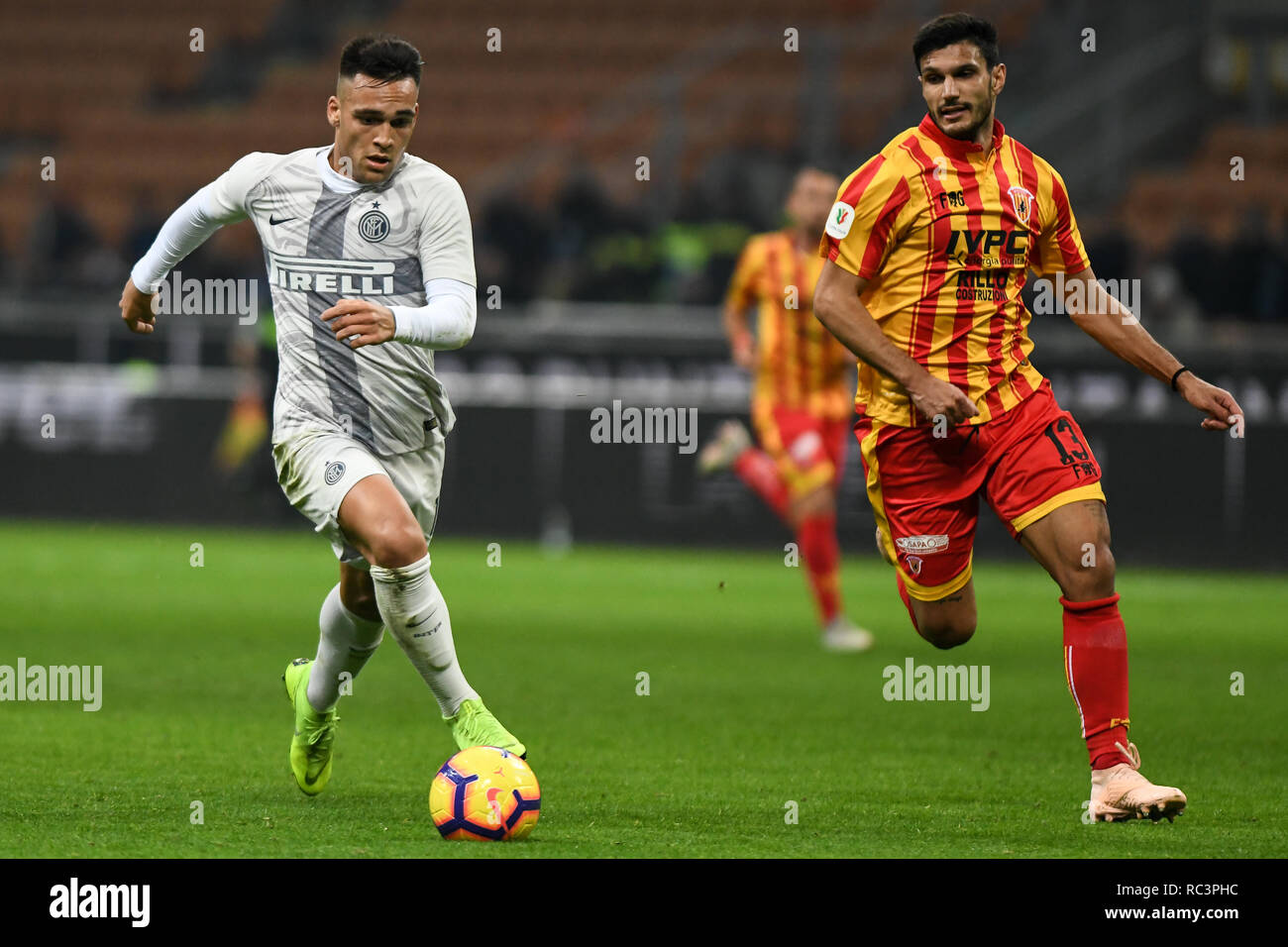 Milan, Italy. 13th Jan 2019. Forward Lautaro Martínez (Inter) controls the ball with Defender Alessandro Tuia during the Italian Cup 'Coppa Italia' football match, Inter Milan vs Benevento Calcio at San Siro Meazza Stadium in Milan, Italy on 13 January 2019. The football match is played behind closed doors after Napoli's Senegalese player Kalidou Koulibaly was subject to racist chants by FC Internazionale's 'ultra' fans during the Boxing Day match. Credit: Piero Cruciatti/Alamy Live News Stock Photo