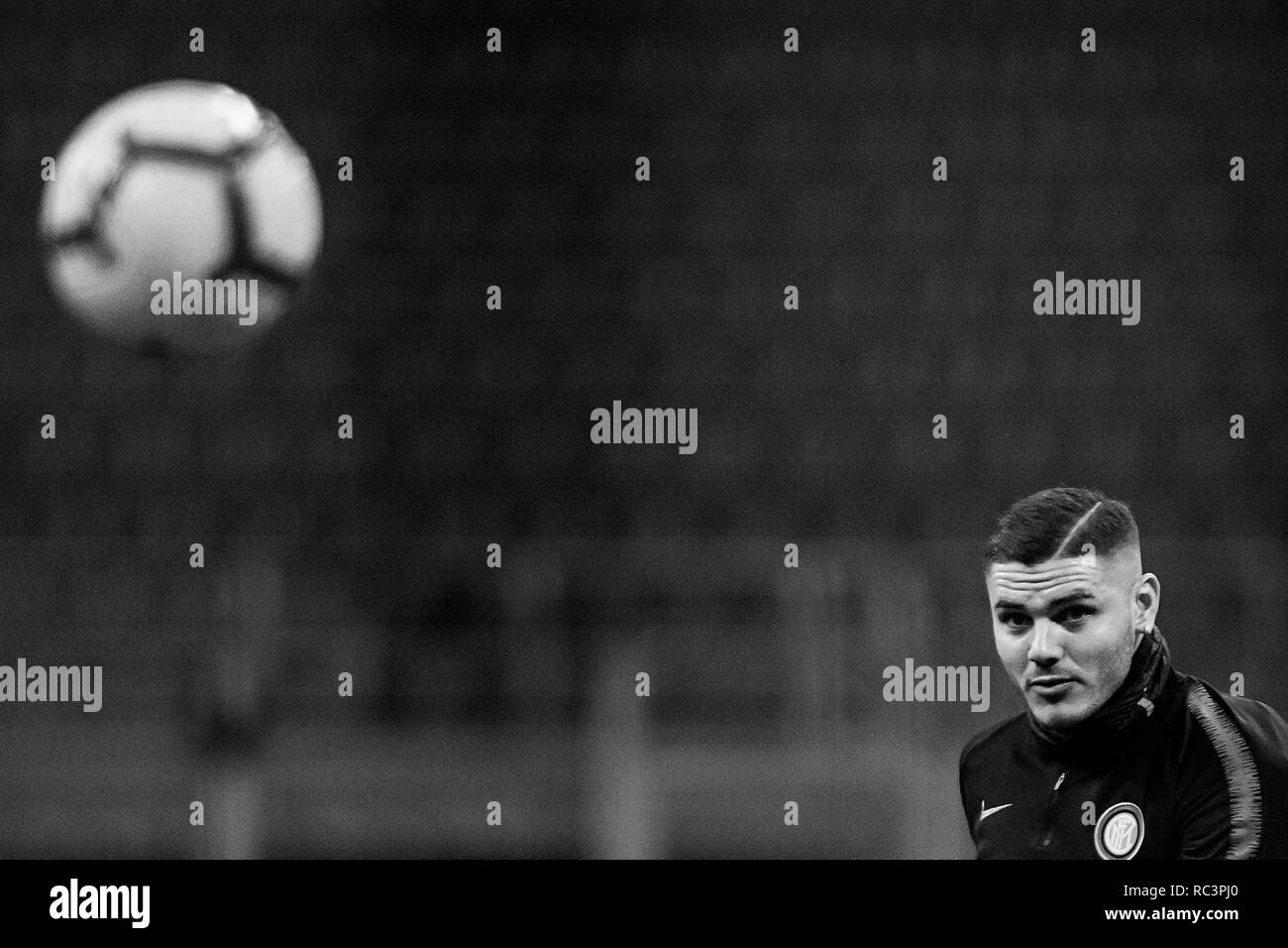 Black and White image of Forward Mauro Icardi (Inter) looking the ball before the Italian Cup 'Coppa Italia' football match, Inter Milan vs Benevento Calcio at San Siro Meazza Stadium in Milan, Italy on 13 January 2019. The football match is played behind closed doors after Napoli's Senegalese player Kalidou Koulibaly was subject to racist chants by FC Internazionale's 'ultra' fans during the Boxing Day match. Credit: Piero Cruciatti/Alamy Live News - Stock Image