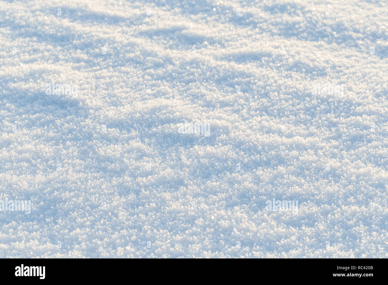 Close-up of fresh snow on the ground on a sunny day, good as a winter season background. Stock Photo