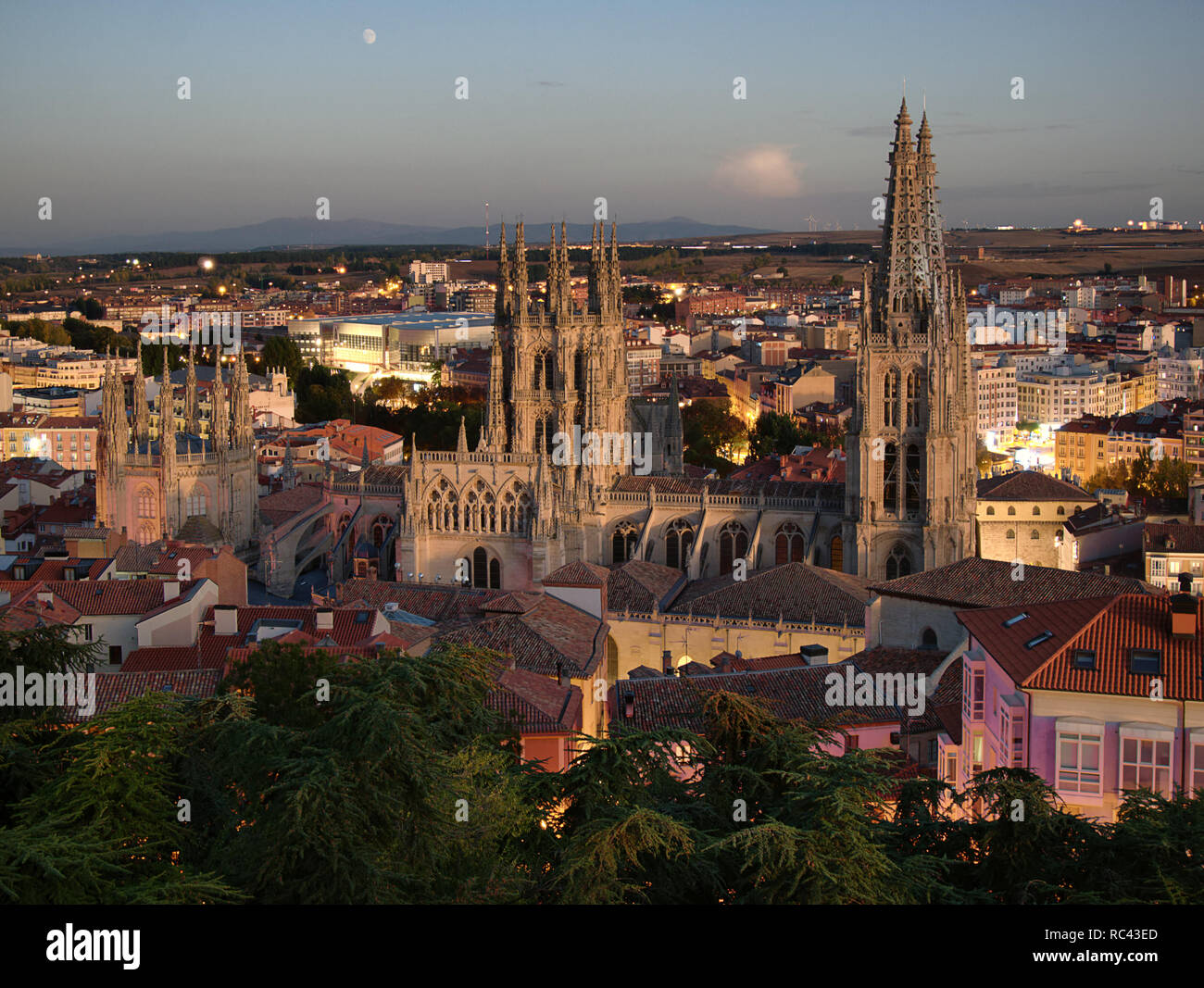 Time-blended sunset/night view over the city and cathedral of Burgos in Spain - Stock Image