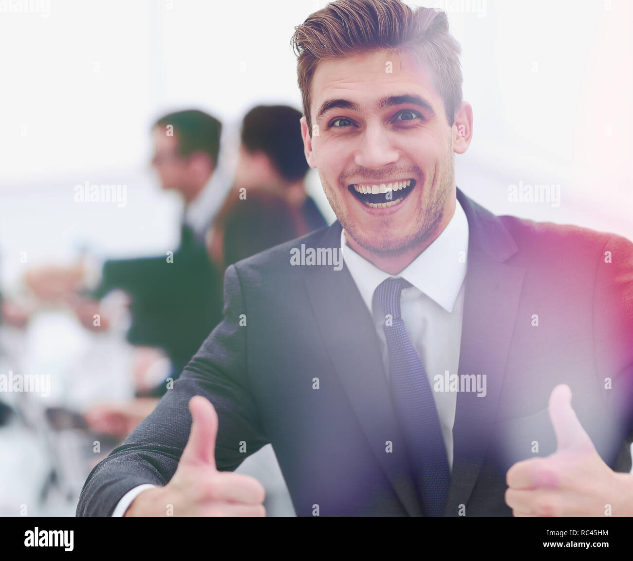 happy businessman showing thumbs up Stock Photo