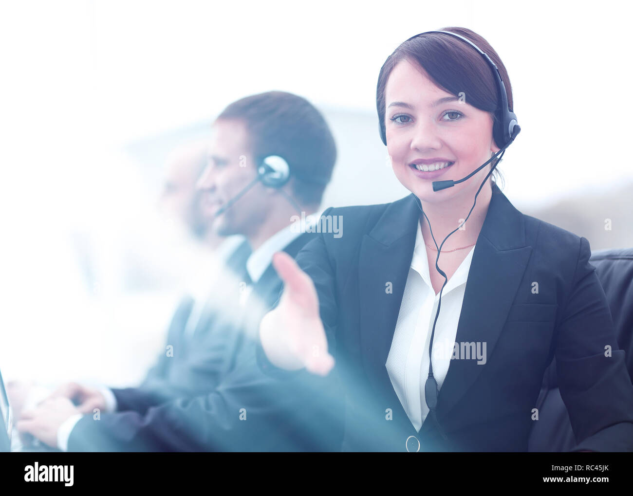 Manager of call center reaches out to shake hands. Stock Photo