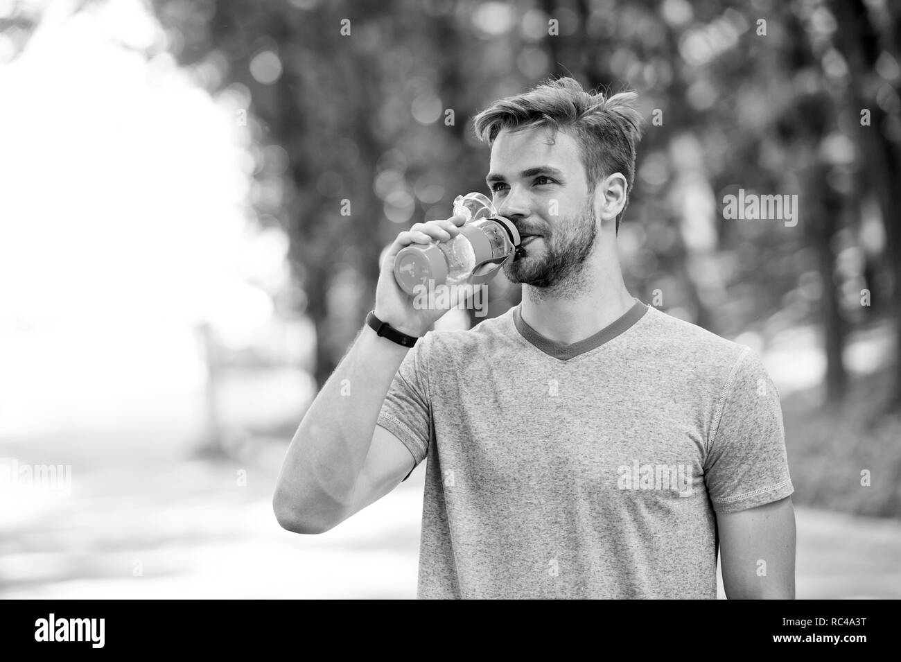 quench your thirst. man feel thirst. man drink water because of thirst. thirst feeling of man after workout - Stock Image