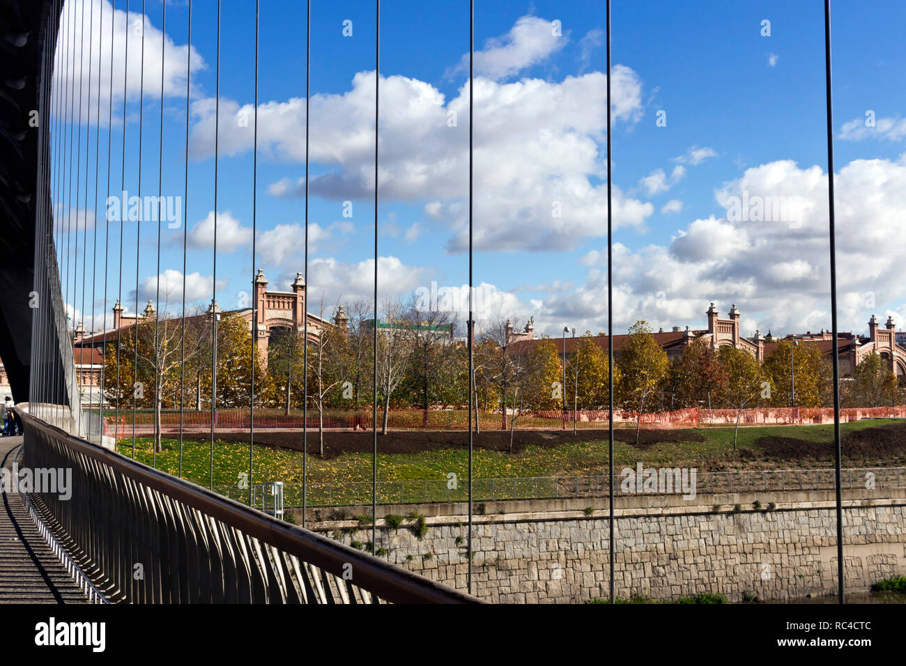 Matadero Madrid, industrial architecture - View from Puente de Matadero, on Manzanares river Stock Photo