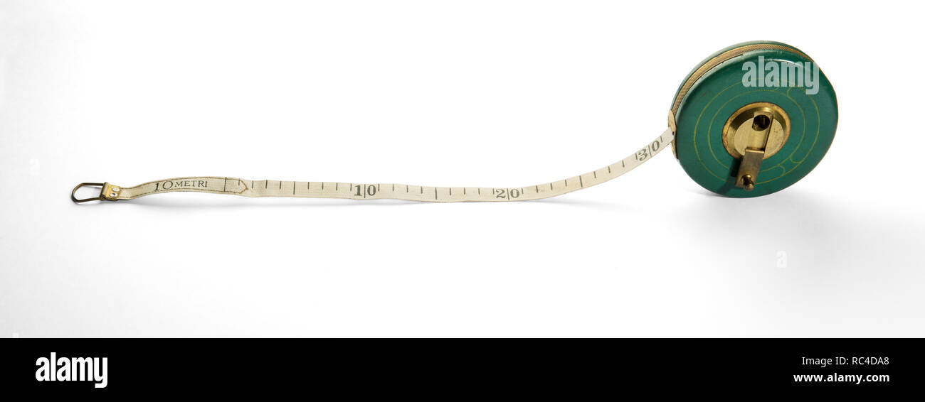 Vintage 10 meter measuring tape unrolled horizontally on white background - Stock Image
