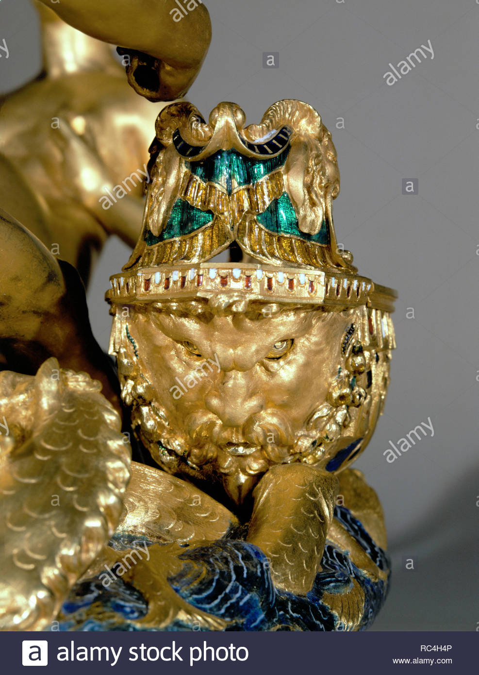 Ship stern in form of grim face. Detail of the saliera (saltcellar) Neptune (sea) and Tellus (earth). Gold, niello work, and ebony base (1540-1543) Height 26 cm Inv. 881. Author: CELLINI, BENVENUTO. Location: Kunsthistorisches Museum, Kunstkammer, Vienna, Austria. - Stock Image