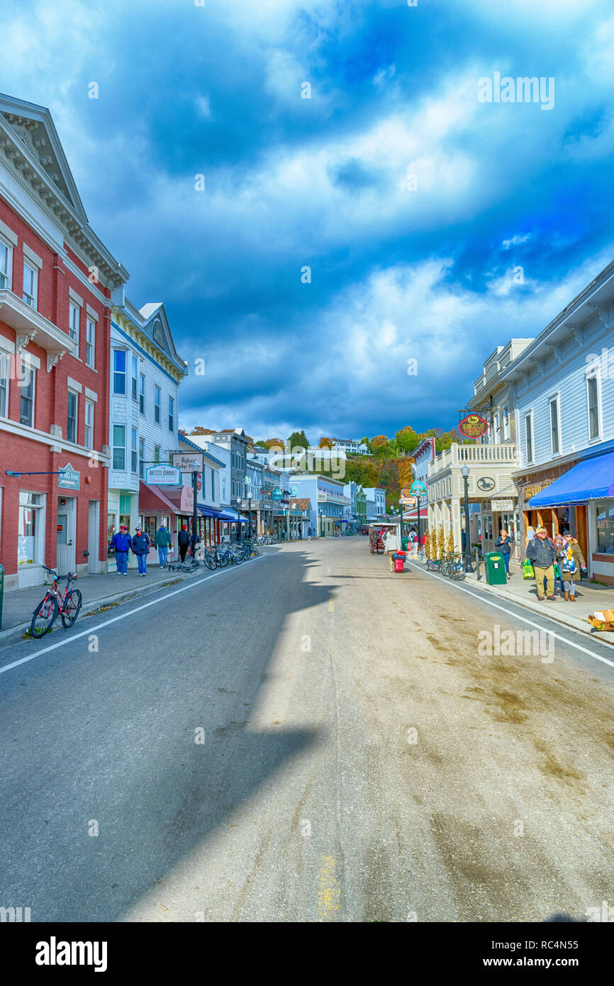 Main Street Mackinac Island, Michigan / United States - October 16, 2018:  Tourists enjoying the island on a windy day in October. Stock Photo