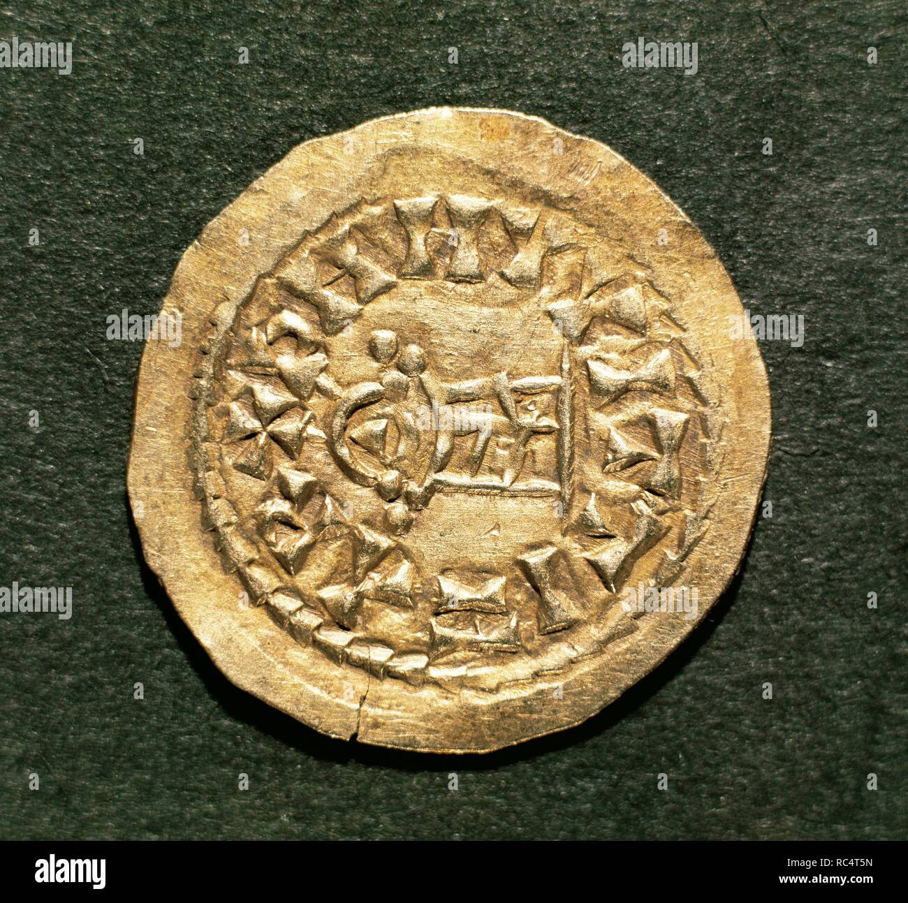 High Middle Ages. 5th-8th centuries. Iberian Peninsula. Visigoth coin. Gold. Spain. Numismatic Cabinet of Catalonia. National art Museum of Catalonia (MNAC), Barcelona, Spain. - Stock Image