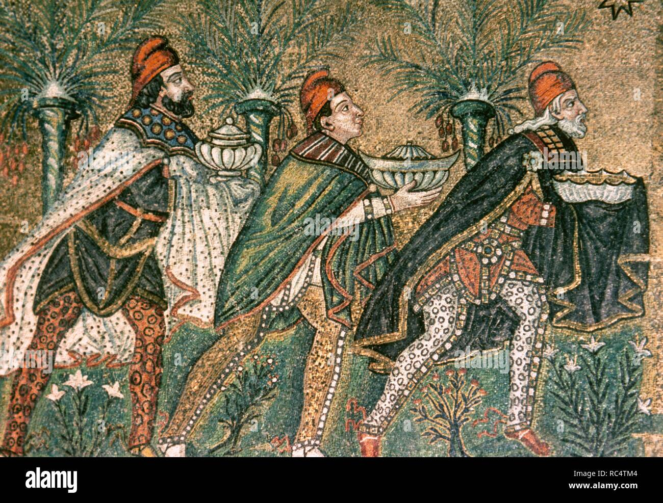 The Three Magi. Byzantine mosaic. Ca. 550. Detail. Restored in 18th century. Depicted in Persian clothing with breeches, capes, and Phrygian caps. Basilica of Sant' Apollinare Nuovo. Ravenna. Italy. Stock Photo