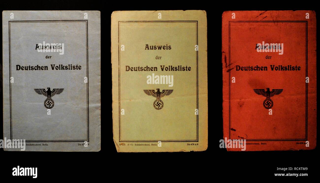 History of Nazism. Occupied Territories. Poland. The people registered in the Volksliste (List of the German people) received identity cards of different colors, depending on the group in which they are classified. Blue for the first and second group, green for the third and red for the fourth. Stock Photo