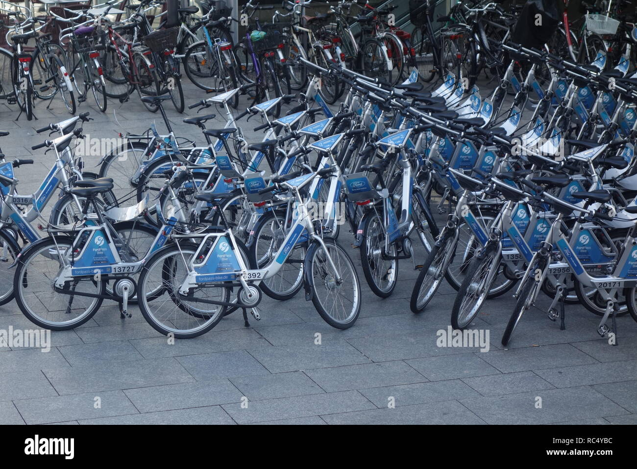 Bicycles for hire outside the main train station in Cologne, one of several bike hire schemes available in the city. Stock Photo