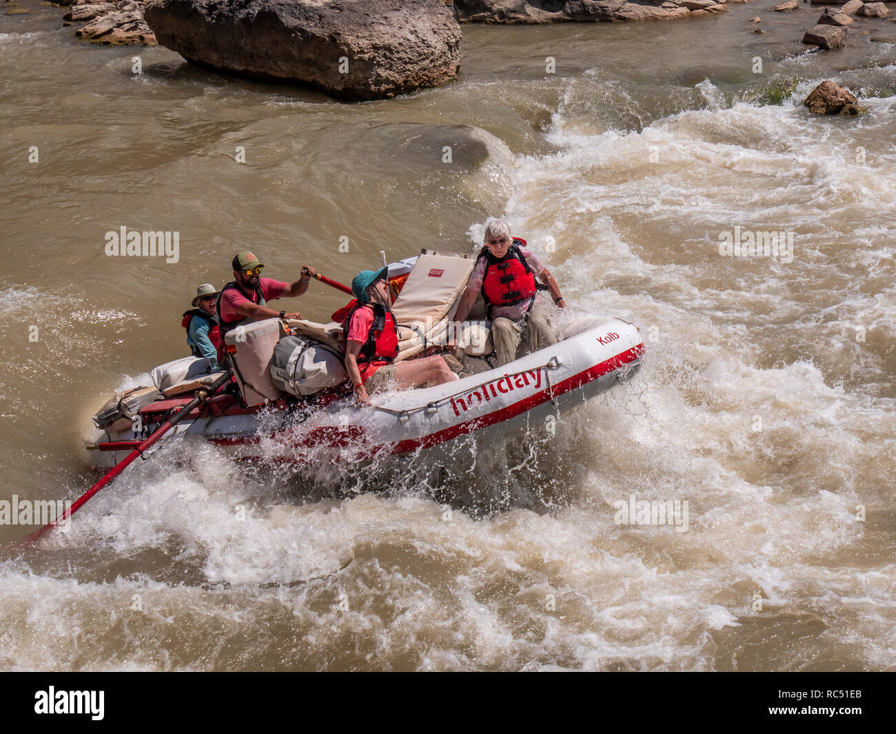 Guide rows through Three Fords Rapid, lower Desolation Canyon north of Green River, Utah. Stock Photo
