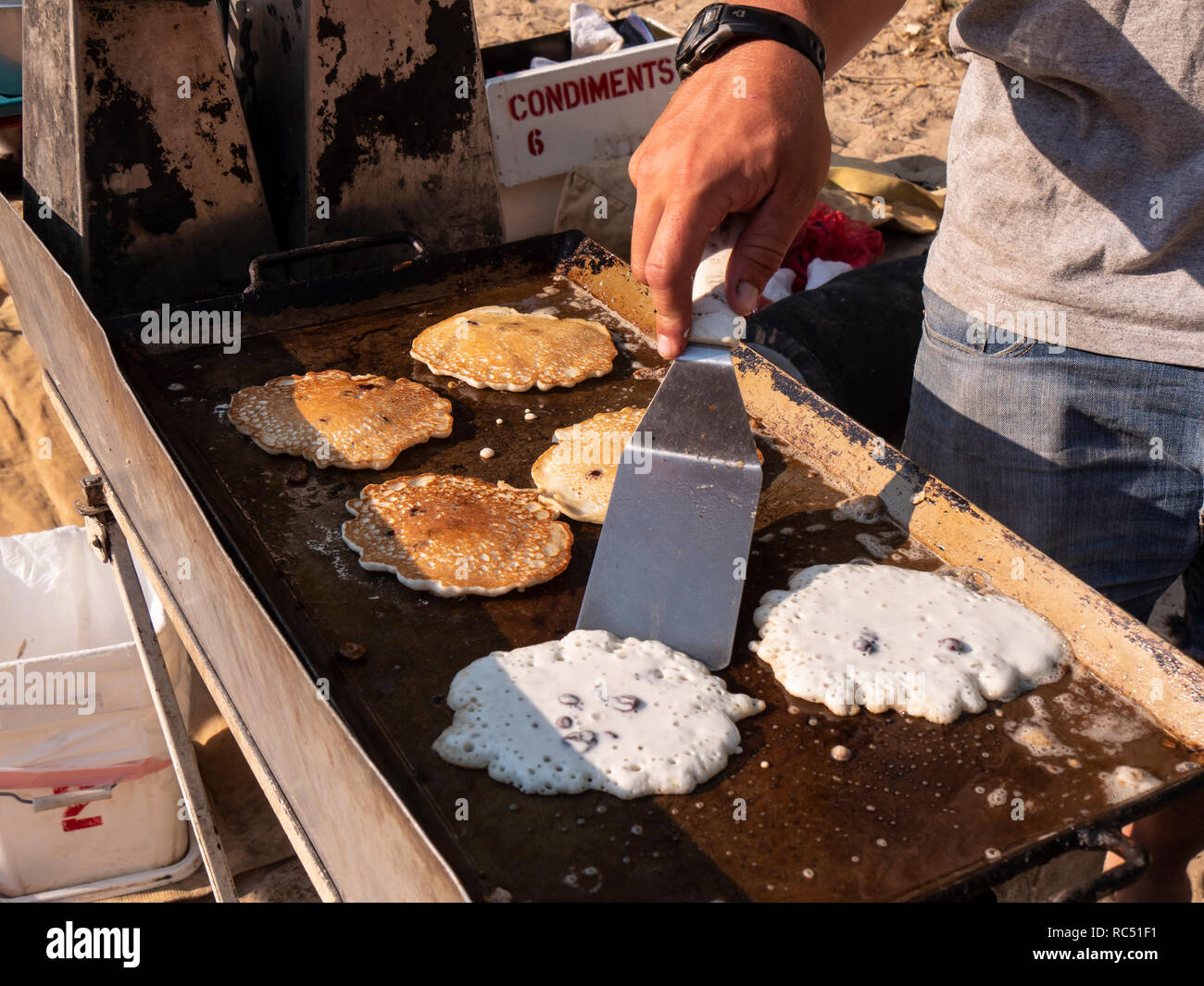 Pancakes on the griddle, Range Creek campsite, Gray Canyon north of Green River, Utah. - Stock Image