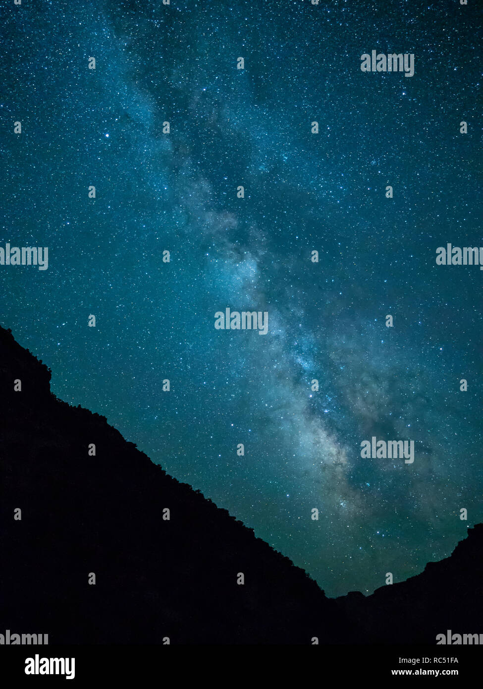 Milky Way from camp below Lion Hollow, Green River in Gray Canyon upstream from Green River, Utah. - Stock Image
