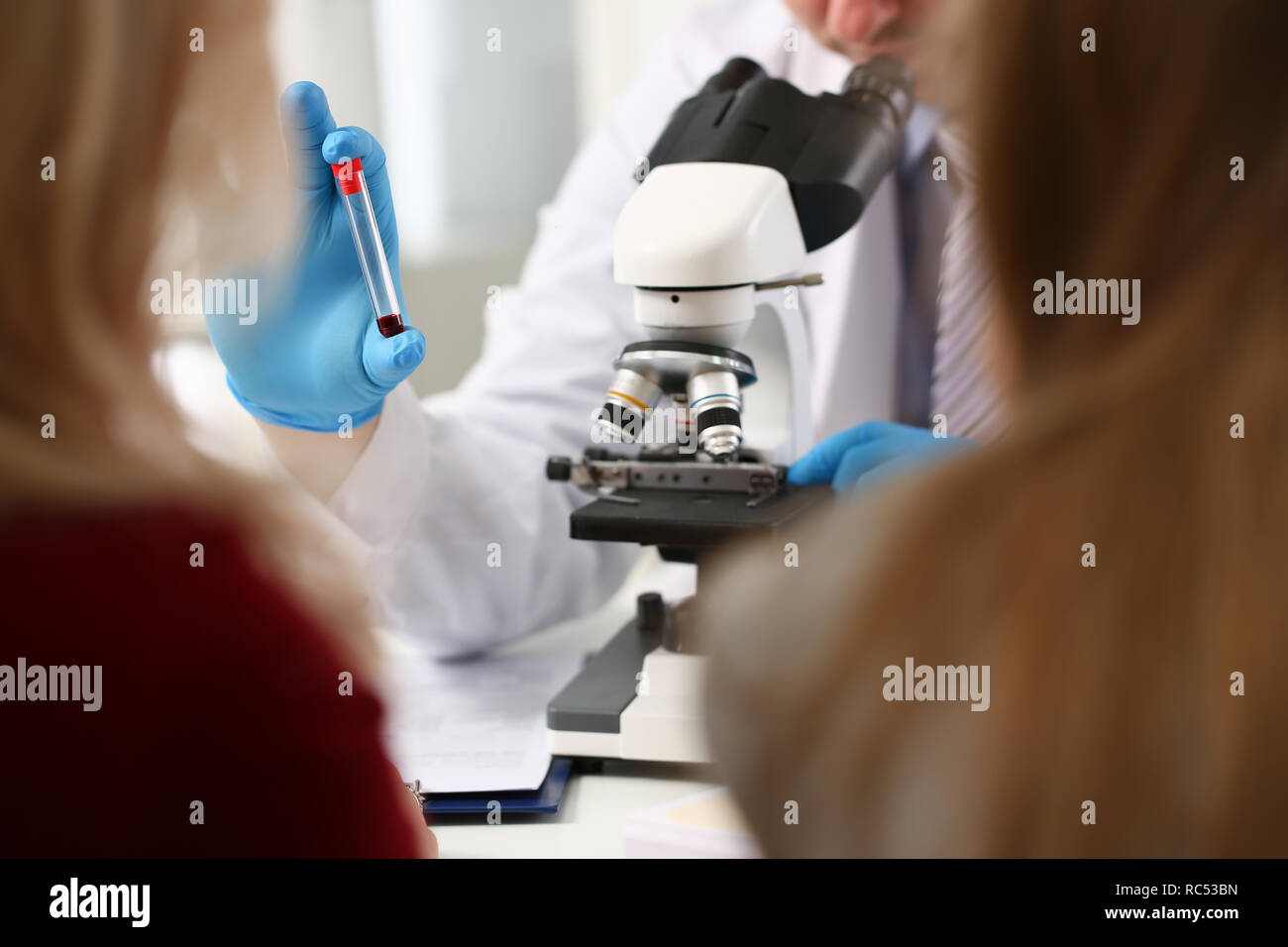 Male hand in blue protective gloves holding - Stock Image