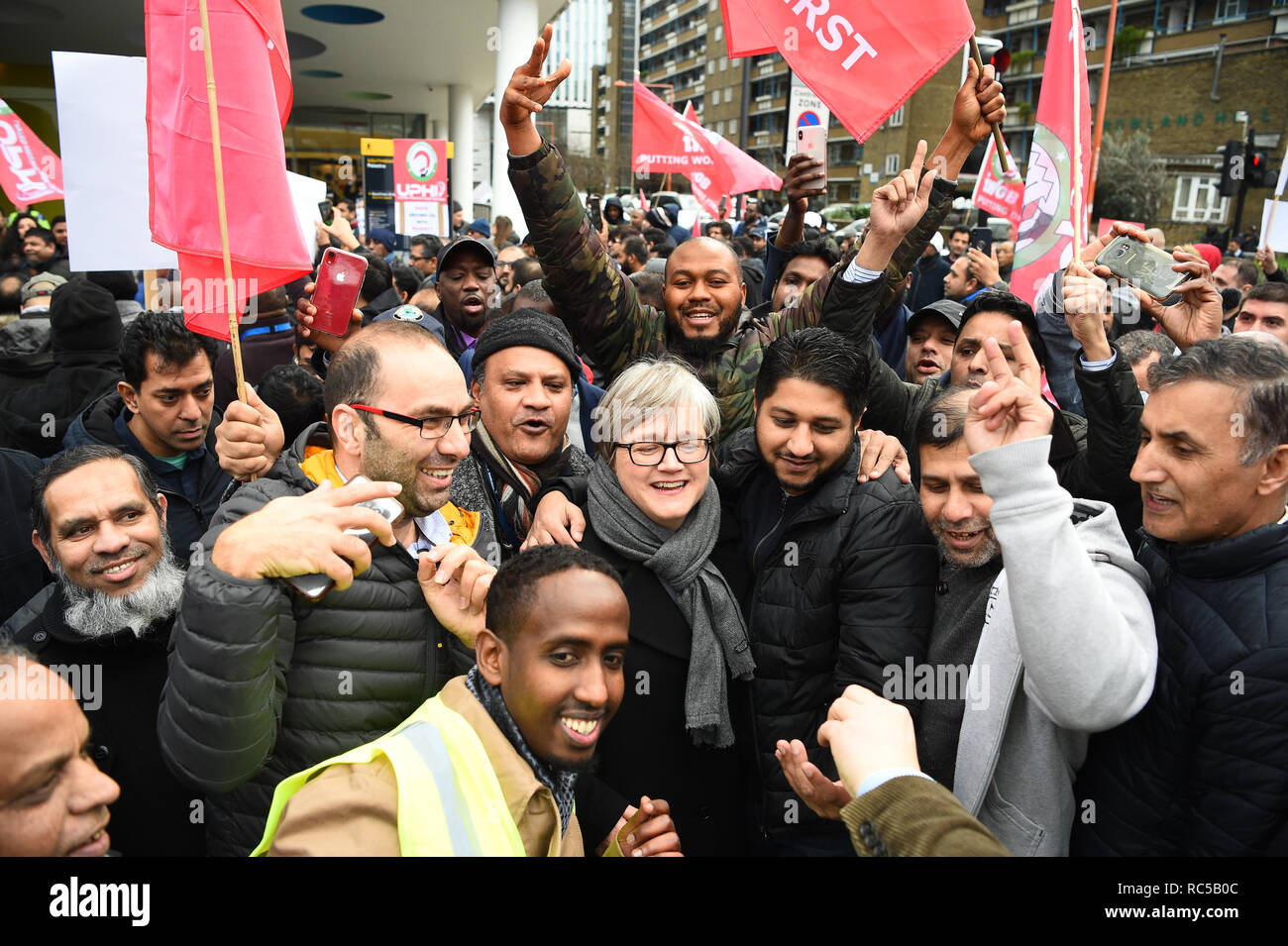 Green Party politician and London Assembly member Caroline Russell (centre) with minicab drivers staging a protest against congestion charges outside the Transport for London offices in London. - Stock Image