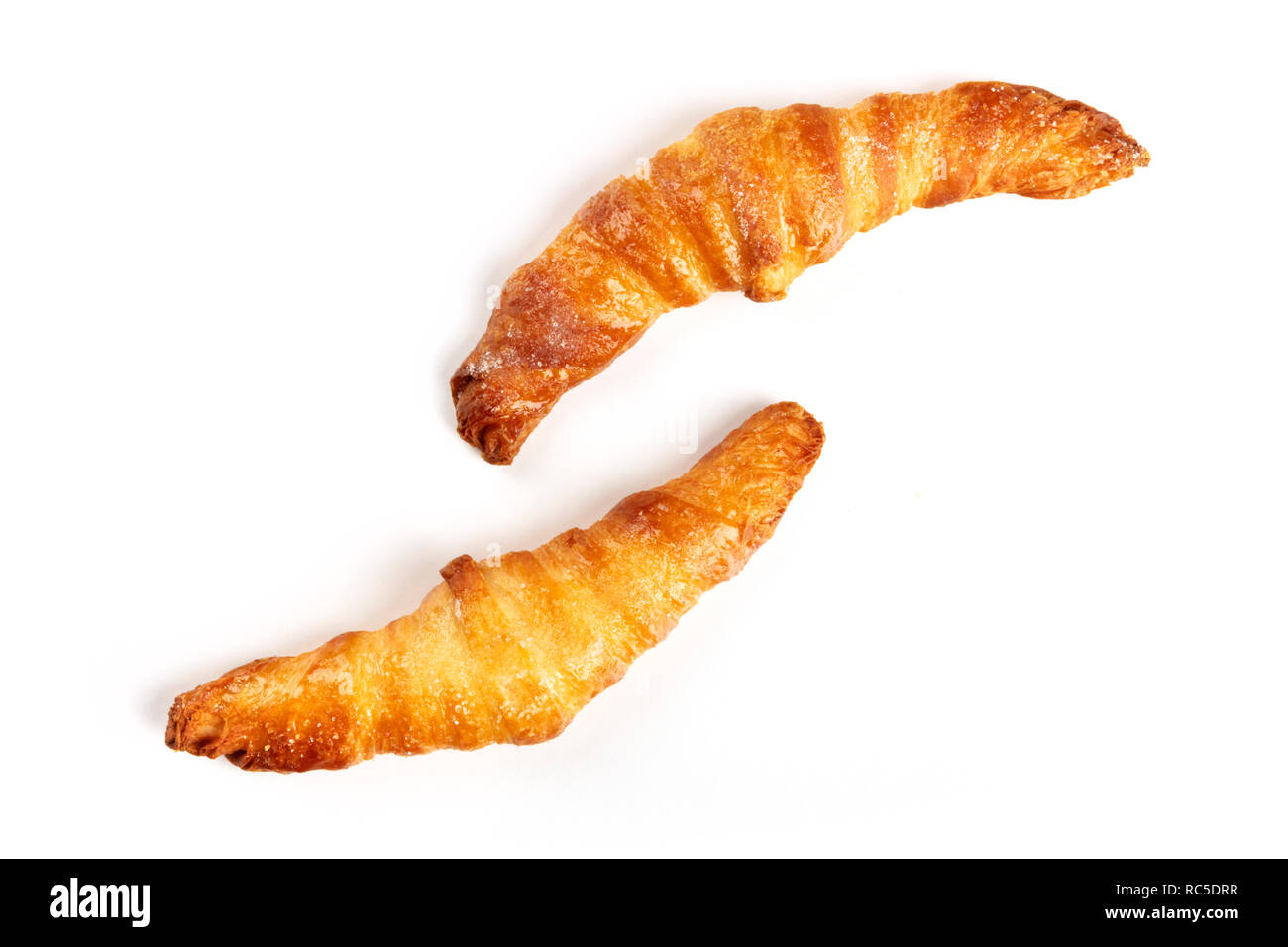 Two croissants on a white background, shot from the top, with a place for text - Stock Image
