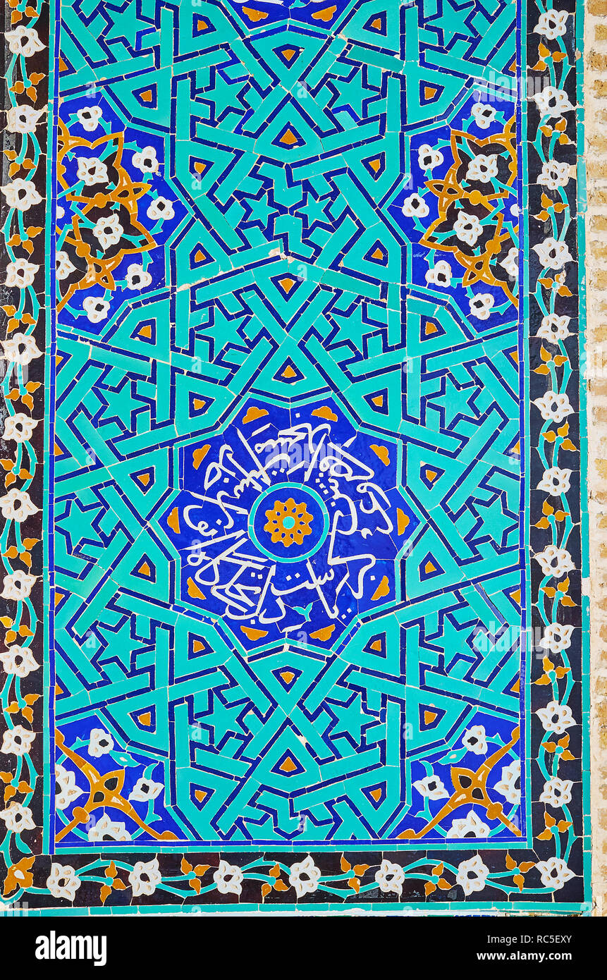 Jameh Mosque of Yazd boasts unique Azari style tiled patterns with floral, geometric, stellar themes and Quranic calligraphy, Iran. - Stock Image