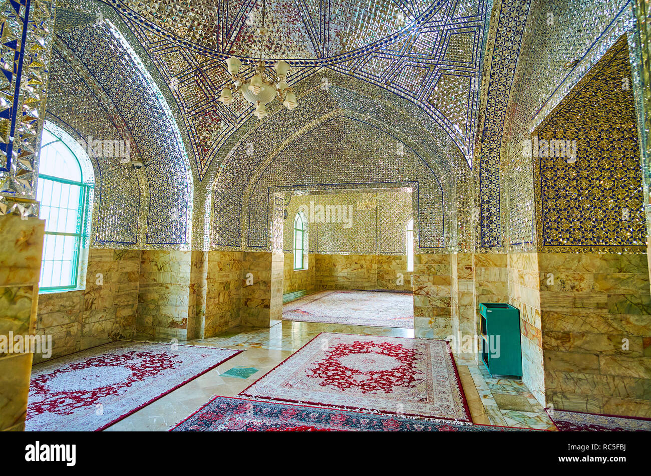 YAZD, IRAN - OCTOBER 18, 2017: The scenic mirror corridor of the modern shrine of Imam Zadeh Jafar with fine Persian carpets on the floor, on October  - Stock Image