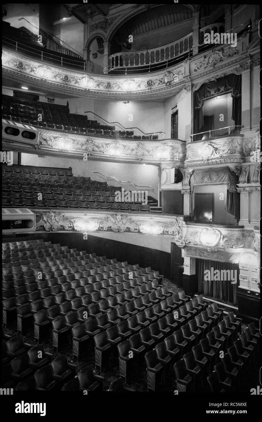Theatre Royal, Grey Street, Grainger Town, Newcastle Upon Tyne, c1955-c1980. An interior view of the Theatre Royal, showing three tiers of balconies and boxes on the right, with the stalls beneath. The theatre dates from 1837, and was designed for Richard Grainger by John and Benjamin Green. The interior was remodelled in 1901 by Frank Matcham, with rich ornamental design, including ornamental plasterwork on the balcony balustrades, with masked busts on the lowest balustrade. - Stock Image