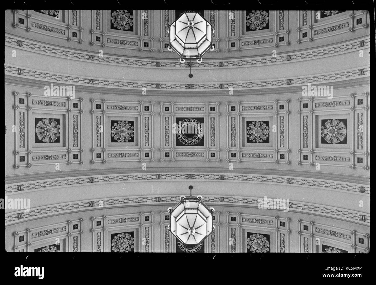 Ceiling of Victoria Hall, Town Hall, Victoria Square, Leeds, West Yorkshire, c1955-c1980. A detailed view of the ceiling in Victoria Hall, the main venue in the Town Hall, showing the richly ornamented ceiling, with individual plaster flowers within decorated squares. The town hall was built 1853-1858 by Cuthbert Brodrick, and alterations made by AW Morant in 1877. The image shows a detailed view of the ceiling, which has bands of ornamented square with individual flowers within them, all painted plasterwork. - Stock Image