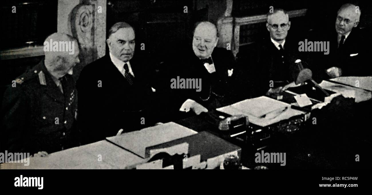 """'Imperial Conference of 1944', 1945. Meeting of the Commonwealth Prime Ministers held in London, 1-16 May, during the Second World War. Left to right: General Jan Smuts of South Africa, William Lyon Mackenzie King of Canada, British Prime Minister Winston Churchill, John Curtin of Australia, and Peter Fraser of New Zealand. Consensus was reached to support the Moscow Declaration, and agreement was made regarding the respective roles in the overall Allied war effort. Churchill (1874-1965) was Prime Minister of the United Kingdom from 1940 to 1945, and again from 1951 to 1955. From """"The Lif - Stock Image"""