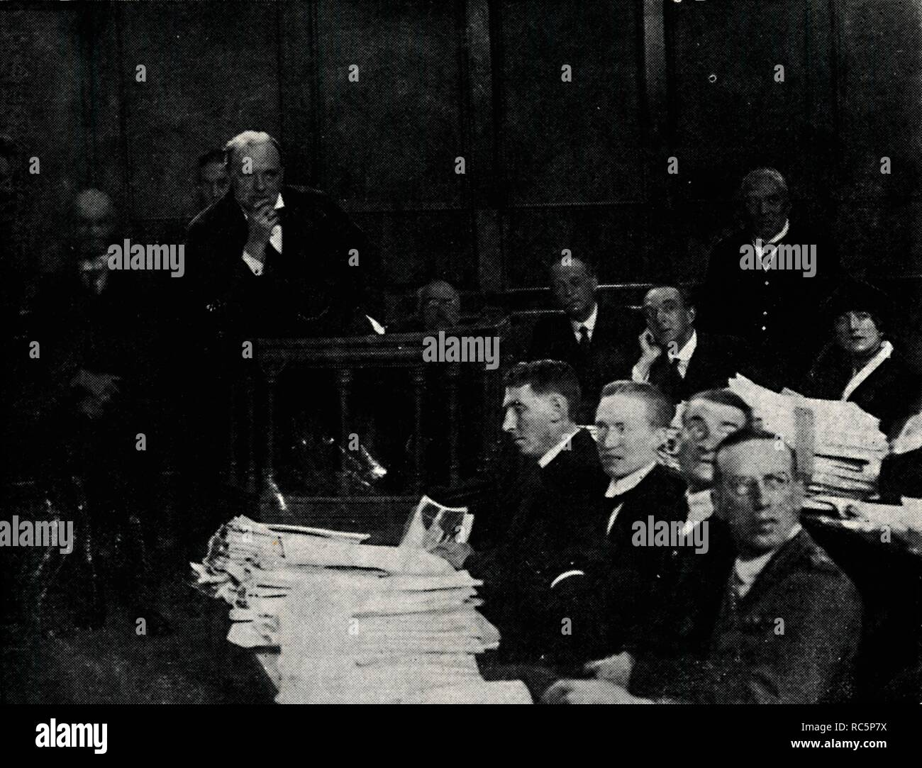 """'Tank Inquiry at Lincoln's Inn', c1919, (1945). British politician and statesman Sir Winston Churchill (1874-1965) at an inquiry in London. Churchill had encouraged the development of the tank, which he believed would be useful in overcoming the problems of trench warfare during the First World War, and financed its creation with admiralty funds. Churchill was Prime Minister of the United Kingdom from 1940 to 1945, and again from 1951 to 1955. From """"The Life and Times of Winston Churchill"""", by Malcolm Thomson. [Odhams Press Limited, London] - Stock Image"""