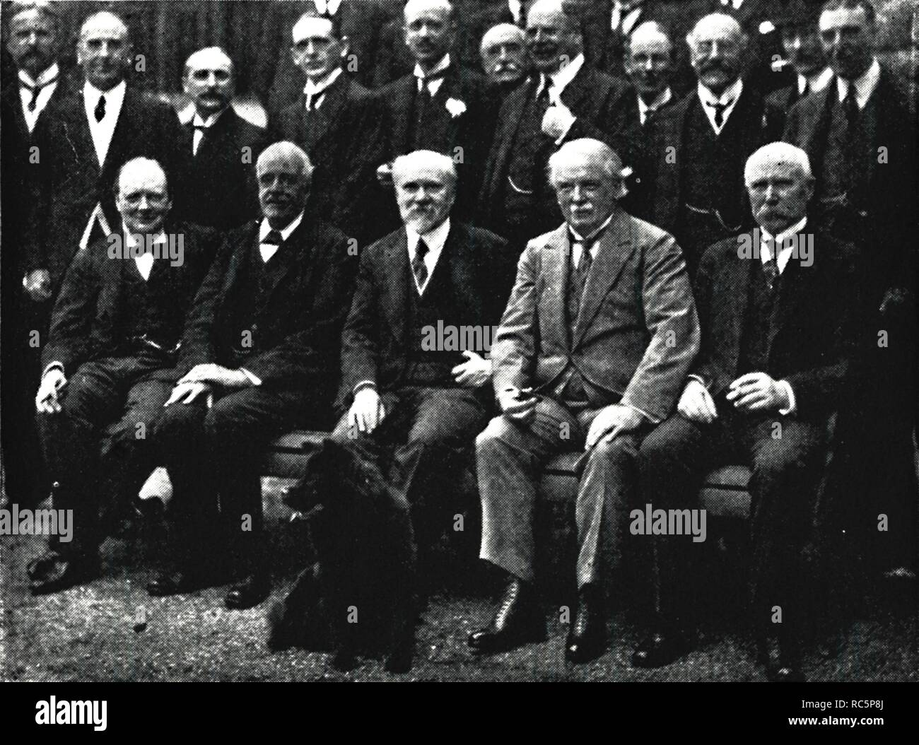 """'At Number 10, Downing Street', c1922, (1945). Sir Winston Churchill (1874-1965) with Arthur Balfour, French President Raymond Poincare, British Prime Minister David Lloyd George and Marshal Philippe Petain, at a lunch given for Poincare. British politician and statesman Winston Churchill was Prime Minister of the United Kingdom from 1940 to 1945, and again from 1951 to 1955. From """"The Life and Times of Winston Churchill"""", by Malcolm Thomson. [Odhams Press Limited, London] - Stock Image"""