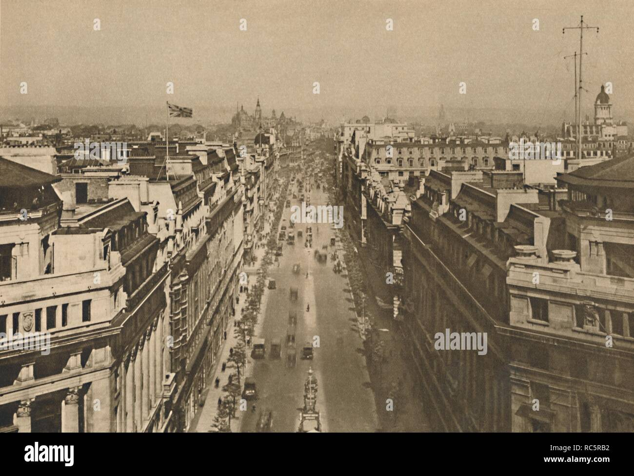 "'On The Roof of Bush House, Looking From Kingsway Towards The Northern Heights', c1935. View from the top of the BBC building at the southern end of Kingsway in central London. Bush House was used to broadcast BBC programmes between 1941 and 2012. To the left is Shell House, and opposite, with wireless telegraphy installation on the roof, is Adastral House, headquarters of the Air Ministry. In the distance is St Pancras Station. From ""Wonderful London, Volume 2"", edited by Arthur St John Adcock. [The Fleetway House, London, c1935] Stock Photo"