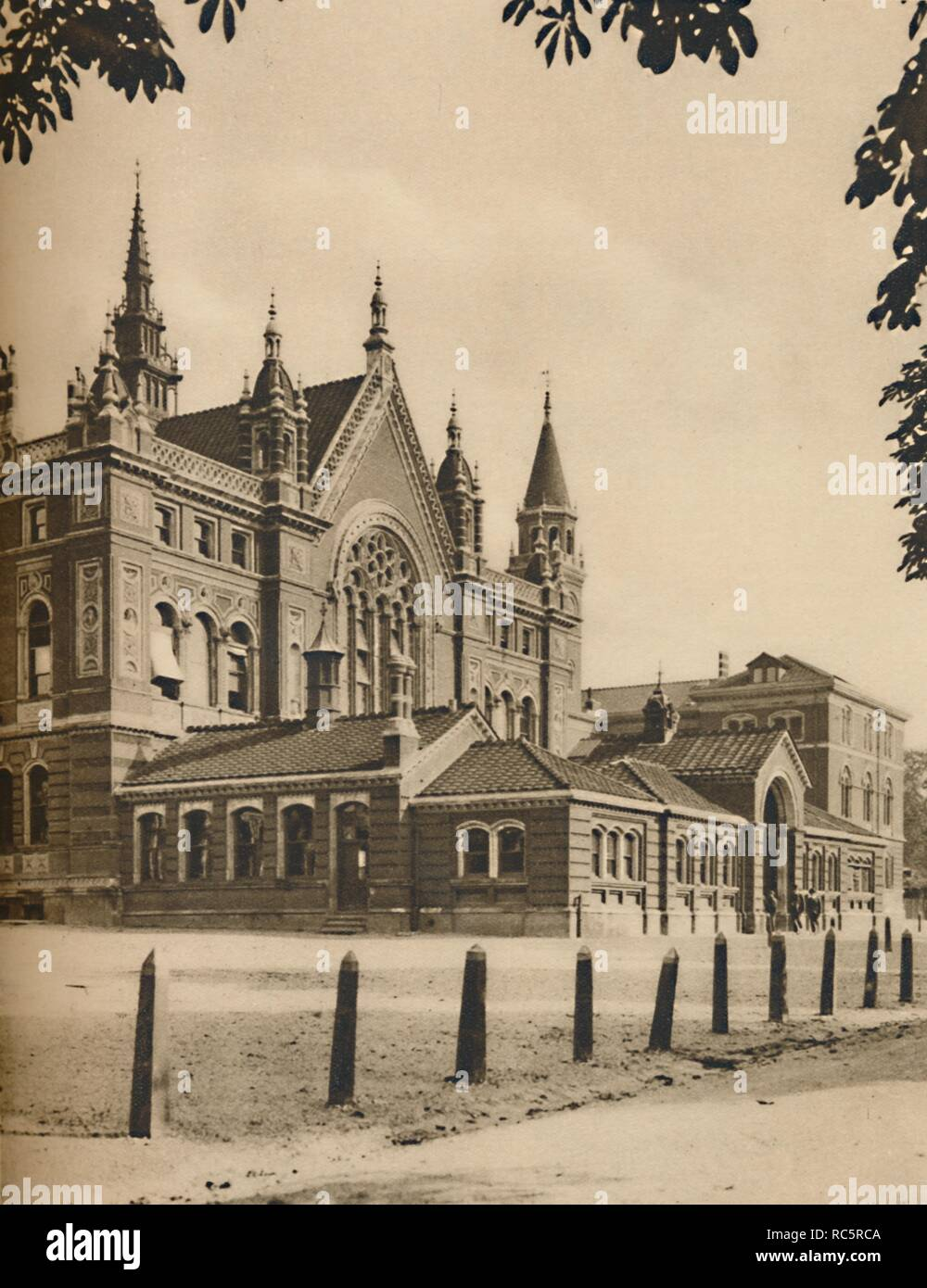 """'The Middle Block and Senior School at Dulwich College', c1935. View of the boys' public school in south-east London which was founded in 1619 by Edward Alleyn, an Elizabethan actor, with the original intention of providing an education for twelve poor boys. The buildings were designed by Charles Barry Junior and opened in 1870. Dulwich College remains an independent public (fee-paying) school. From """"Wonderful London, Volume 2"""", edited by Arthur St John Adcock. [The Fleetway House, London, c1935] - Stock Image"""