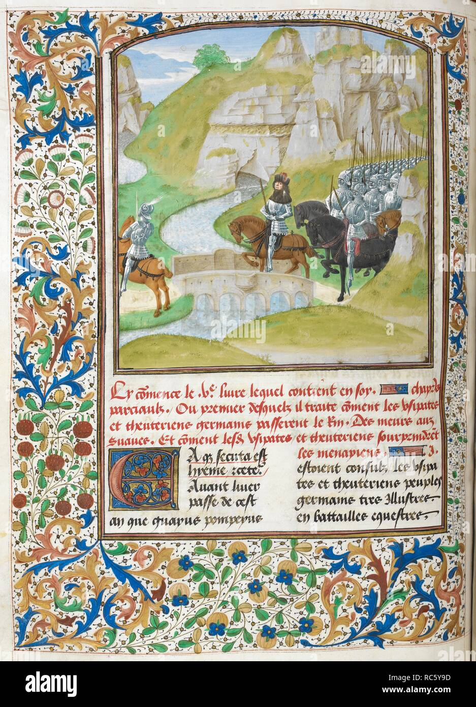 Germanic army crossing the Rhine (Book 5).  Army crossing a river by a bridge, with landscape in the background. Text beginning with decorated initial 'E'. Caesar, translated by Jan Du Quesne (or Jean Duchesne), Bellum Gallicum ( Les commentaires de Cesar ). 1473-1476. Source: Royal 16 G. VIII, f.147v. Language: French. Author: JULIUS CAESAR. Du Quesne, Jehan. Master of the London Wavrin. - Stock Image