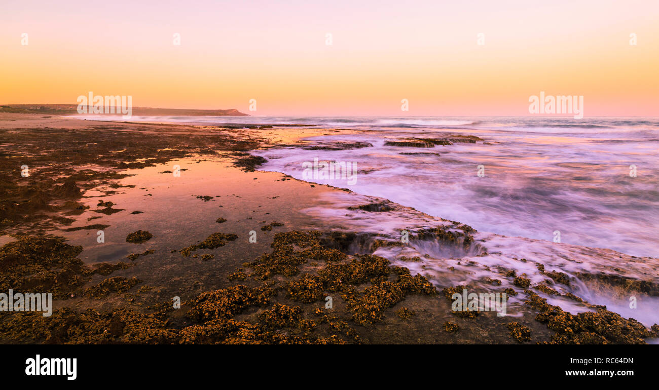 Kalbarri, Western Australia. The limestone coast at Blue Holes with Red Bluff in the distance. - Stock Image