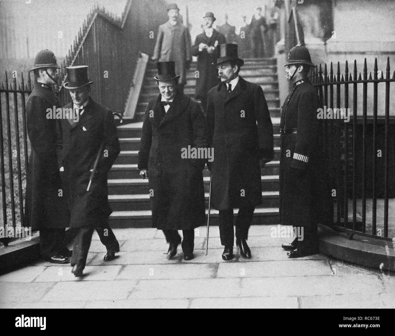 Sir Edward Grey,Winston Churchill and Lord Crewe leaving a cabinet meeting after the Liberal victory in the General Election on 14th February 1910 - Stock Image