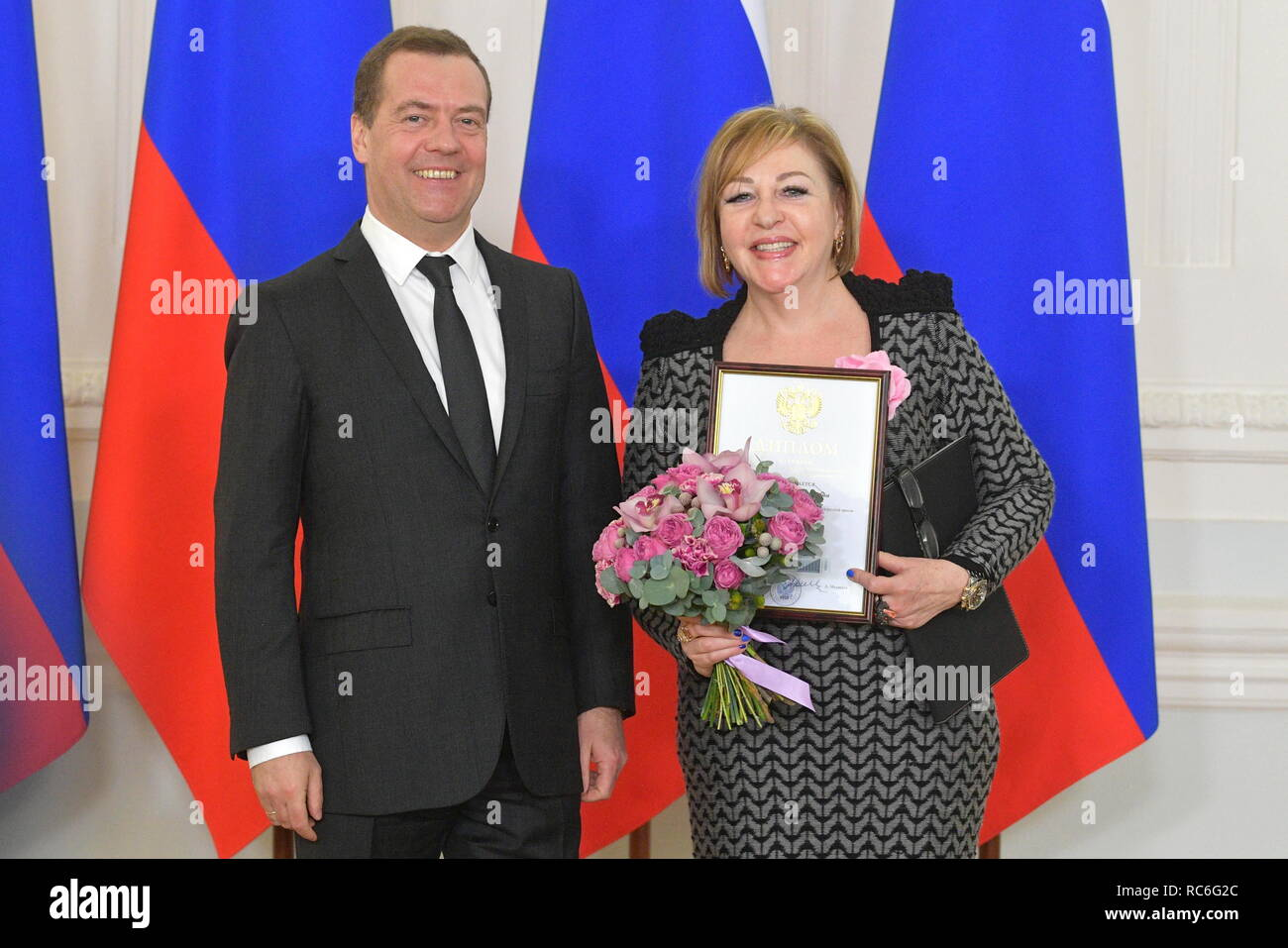 Moscow, Russia. 14th Jan, 2019. MOSCOW, RUSSIA - JANUARY 14, 2019: Russia's Prime Minister Dmitry Medvedev (L) and Marietta Rozental, head of the organizing committee of the 20th World Congress of Russian Press in New York City, at a ceremony to present the 2018 Mass Media government awards. Alexander Astafyev/Russian Government Press Office/TASS Credit: ITAR-TASS News Agency/Alamy Live News - Stock Image