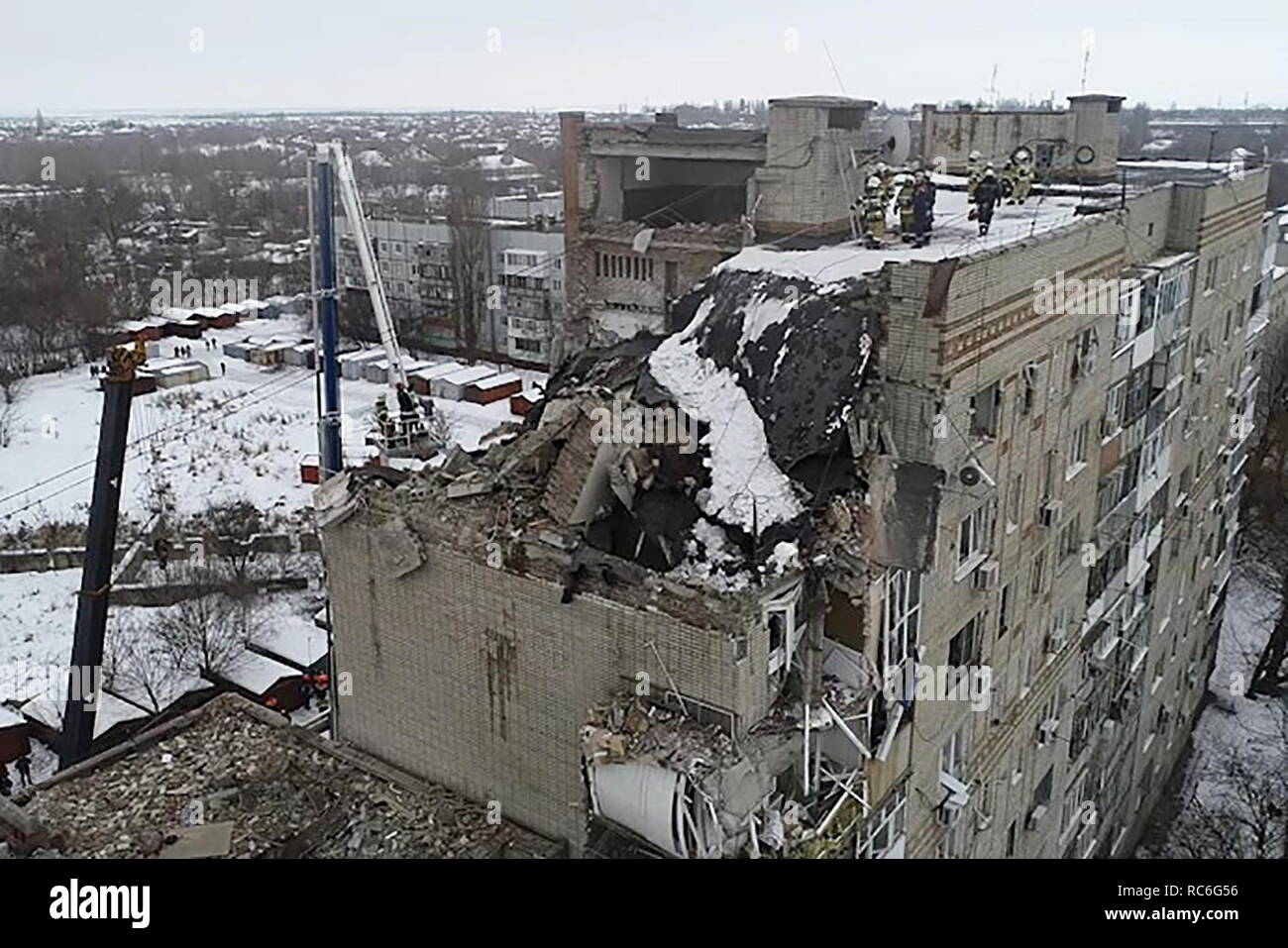 Shakhty, Russia. 14th Jan, 2019. ROSTOV-ON-DON REGION, RUSSIA - JANUARY 14, 2019: An aerial view of the site of a domestic gas explosion which has caused a partial collapse of an apartment building at 16 Khabarova Street in the town of Shakhty. Video screen grab/Russian Emergency Situations Ministry press office/TASS Credit: ITAR-TASS News Agency/Alamy Live News - Stock Image