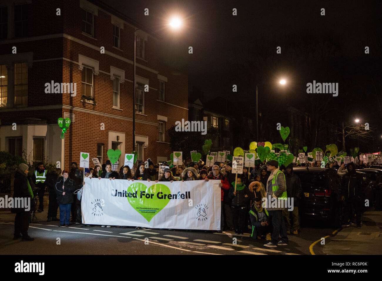 London, UK. 14th January, 2019. Members of the Grenfell community take part in the Grenfell Silent Walk around West Kensington on the monthly anniversary of the fire on 14th June 2017. 72 people died in the Grenfell Tower fire and over 70 were injured. Credit: Mark Kerrison/Alamy Live News - Stock Image
