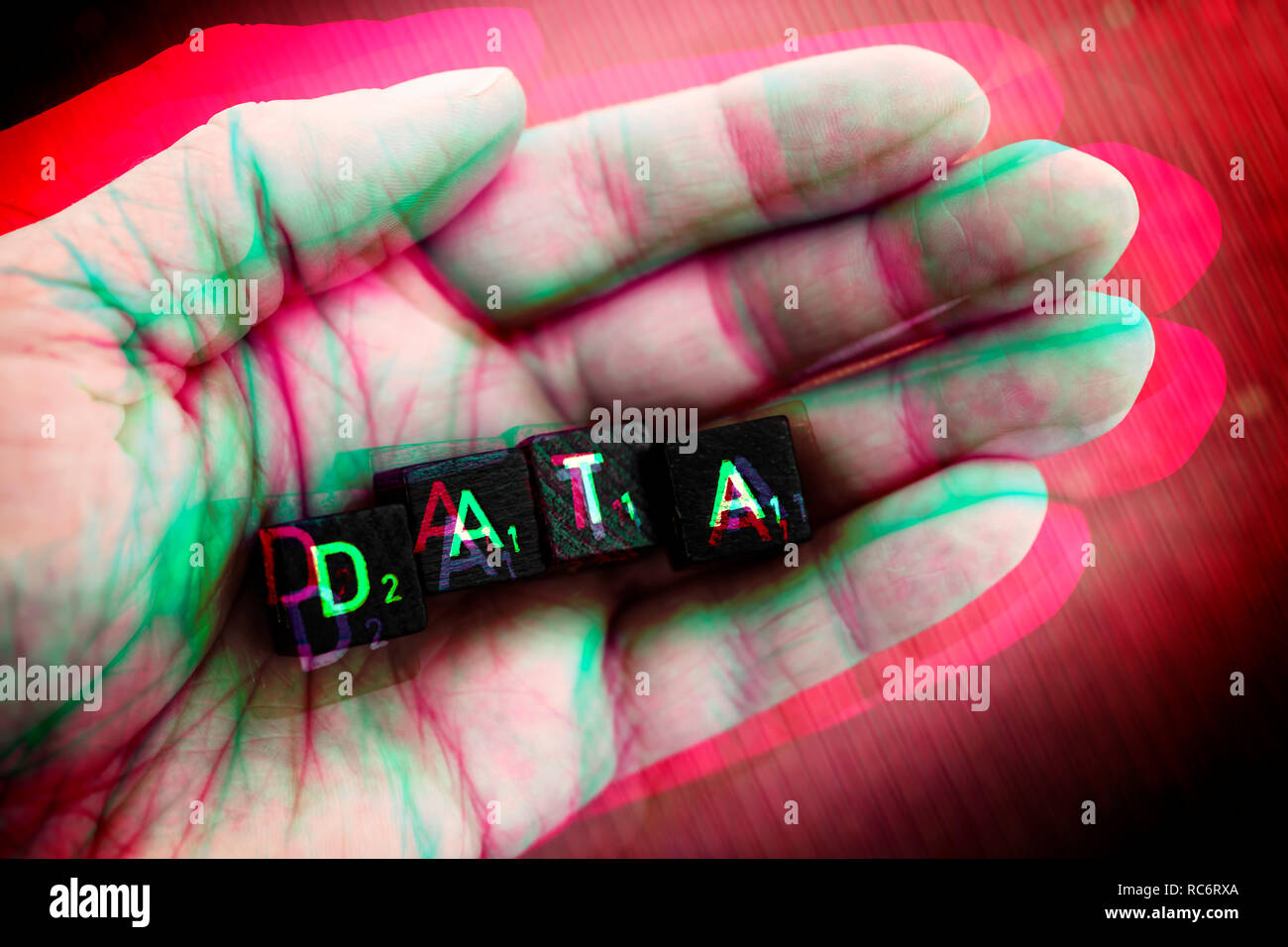 Letter cubes forming the word data on a hand - Stock Image