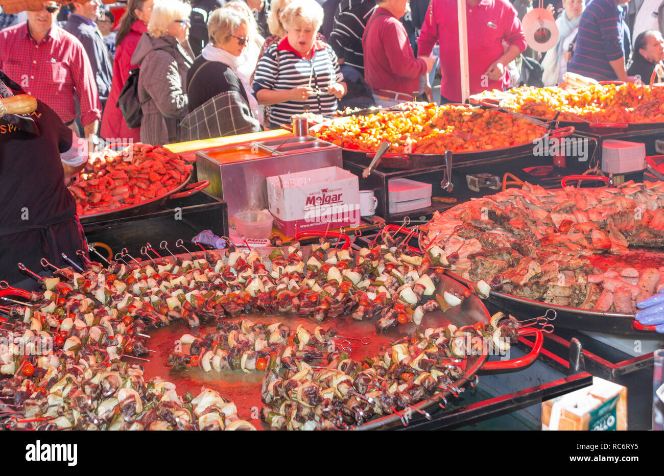 Campillos, Malaga, Spain. Ham and pork products fair. Large pans of sausages, chorizo and other pork related products are served to the many visitors  Stock Photo