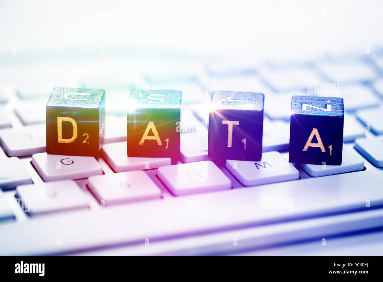 Letter cubes forming the word data on a computer keyboard - Stock Image