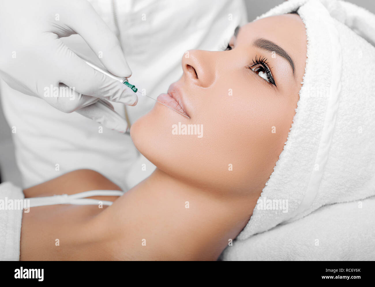 cropped woman face getting facelift , procedure lifting skin Stock Photo