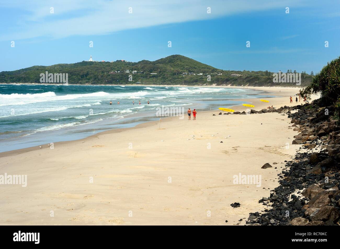 Swimmers in the sea Byron Bay, Australia - Stock Image