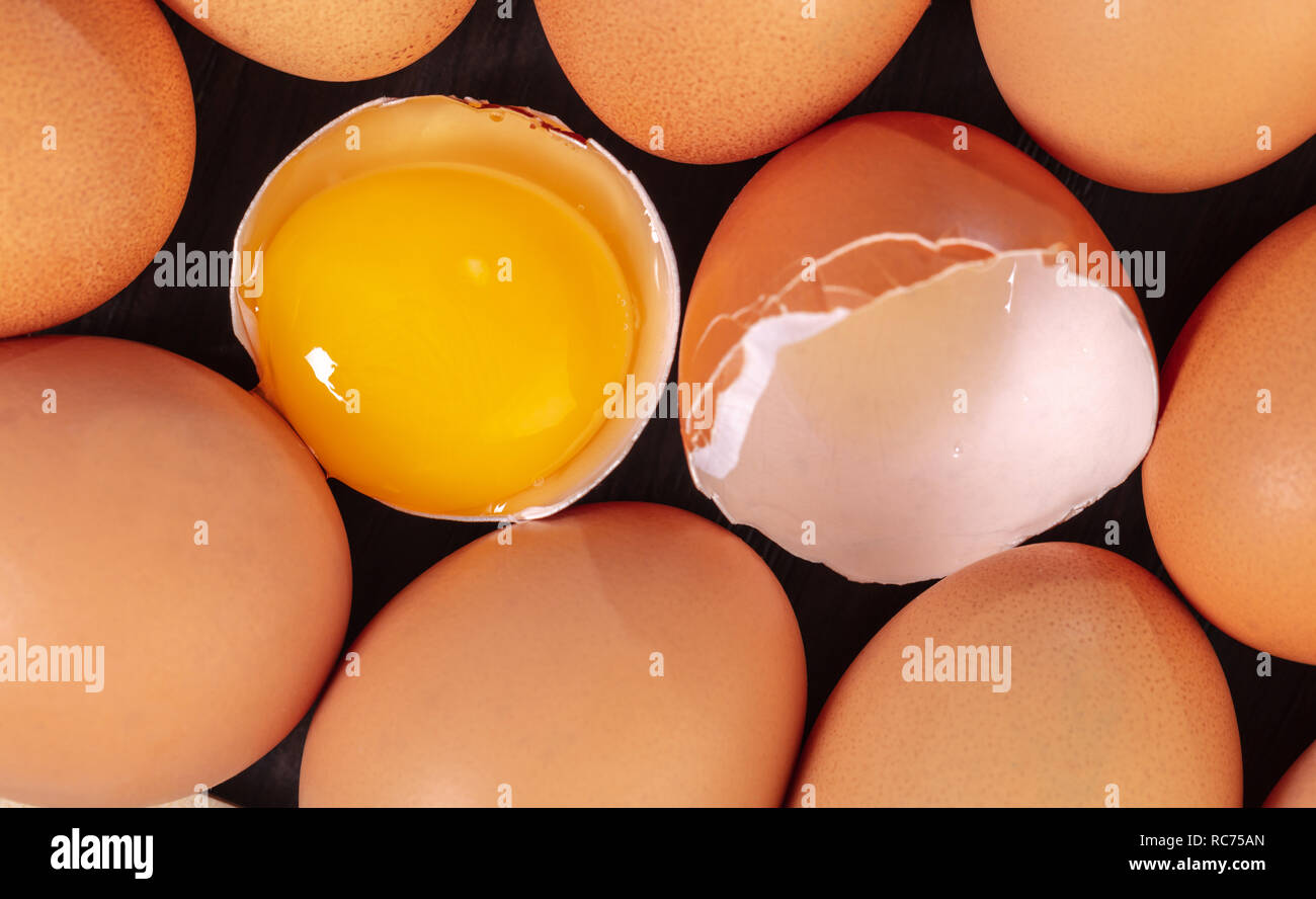 broken and whole chicken eggs, food background Stock Photo