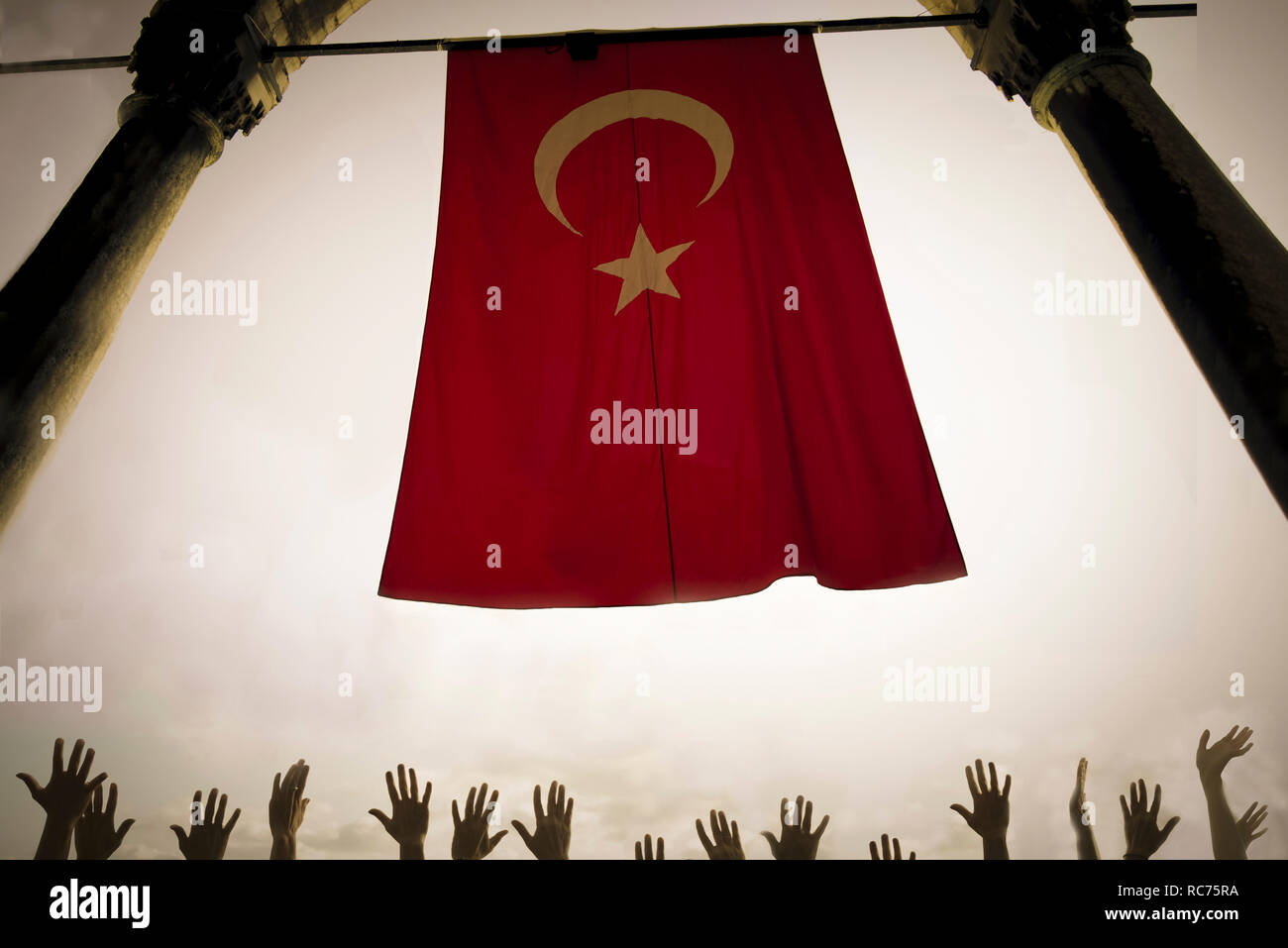 Politics and religion concept with red flag against the sky and lot of hands like prayer or crown concept - muslim and christian culture with war and  - Stock Image