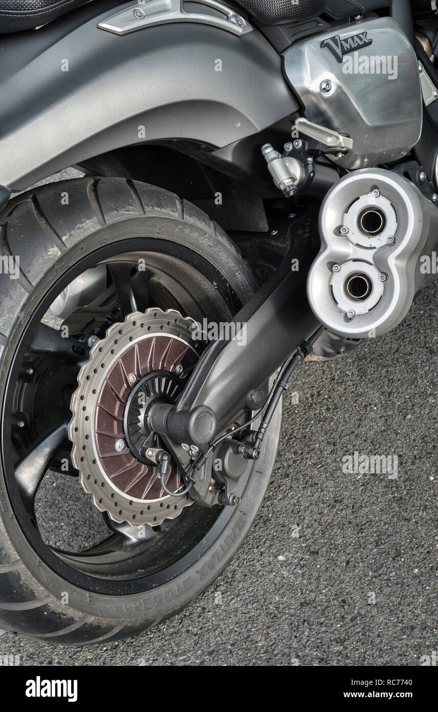 UK. Yamaha VMAX motorcycle, with a 4-cylinder liquid cooled 1679cc V4 engine. Rear wheel and disc brake, closeup - Stock Image