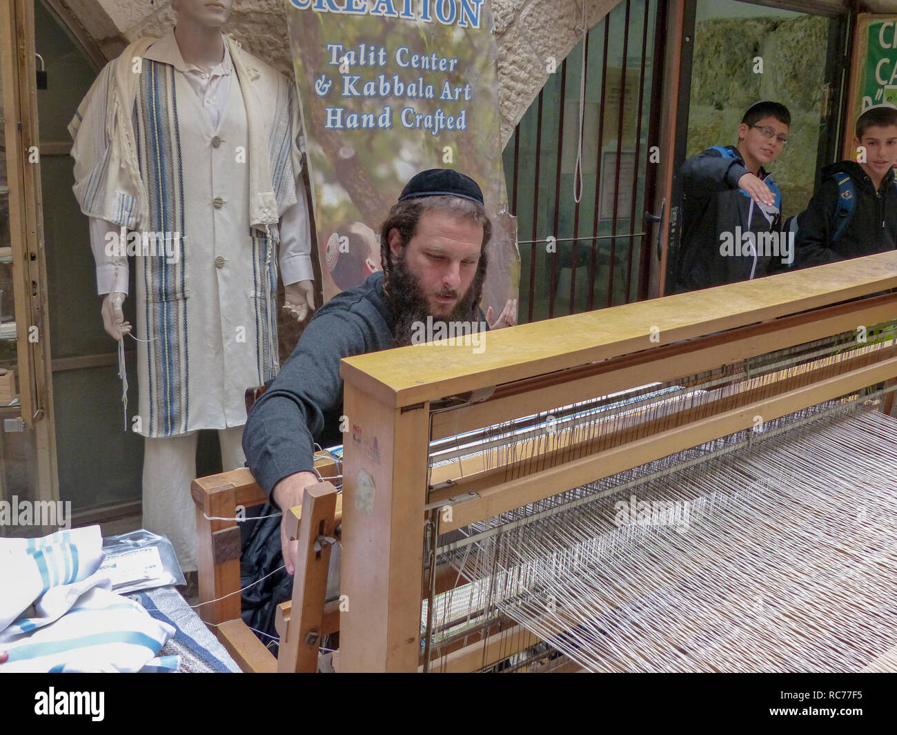 Weaving a talith on a loom Photographed in Jerusalem The Jewish Quarter in the Old City, Israel, - Stock Image