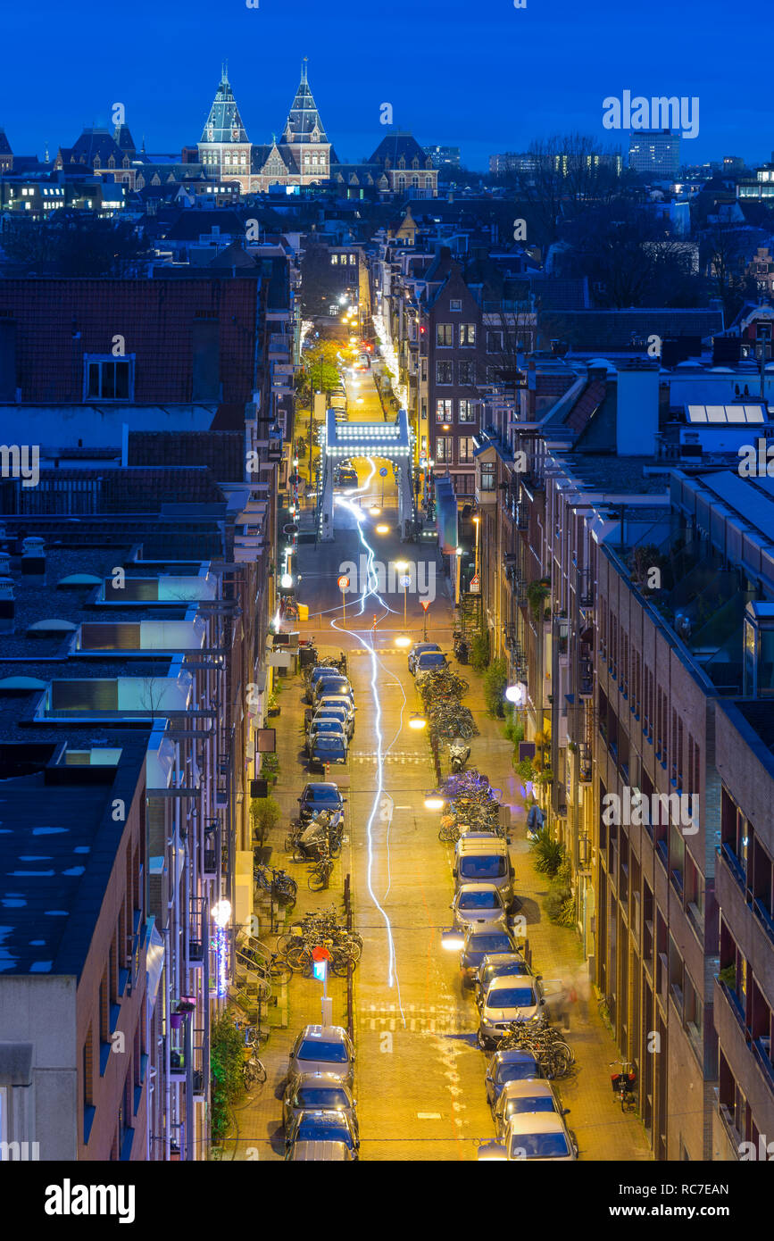 Amsterdam street at night with Skinny Bridge (Mager Brug) and Rijksmuseum. High angle view. Stock Photo