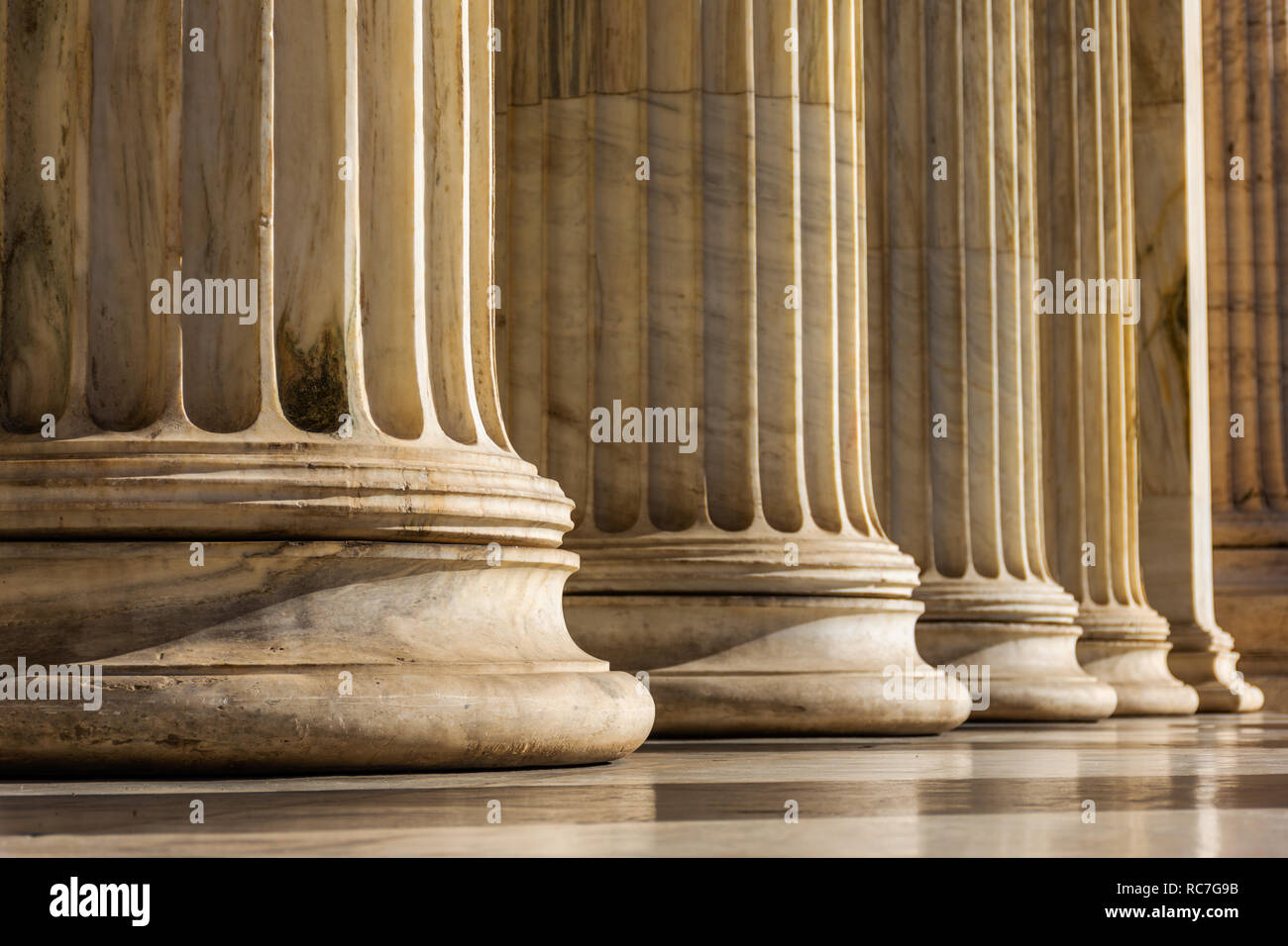 Classical marble pillars detail on the facade of National Academy of Athens, Greece Stock Photo
