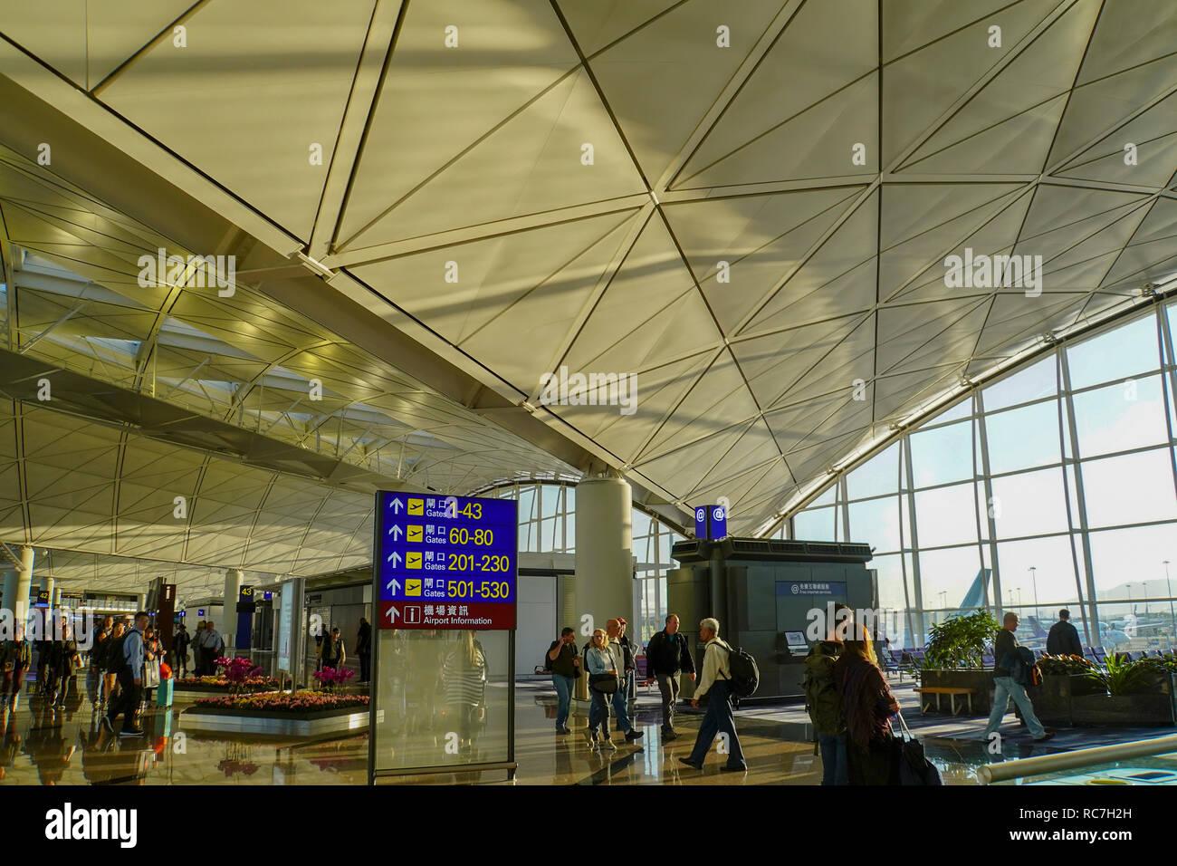 Asia, Southeast, People's Republic of China, Hong Kong, people waiting for the flight at Hong Kong international airport. - Stock Image