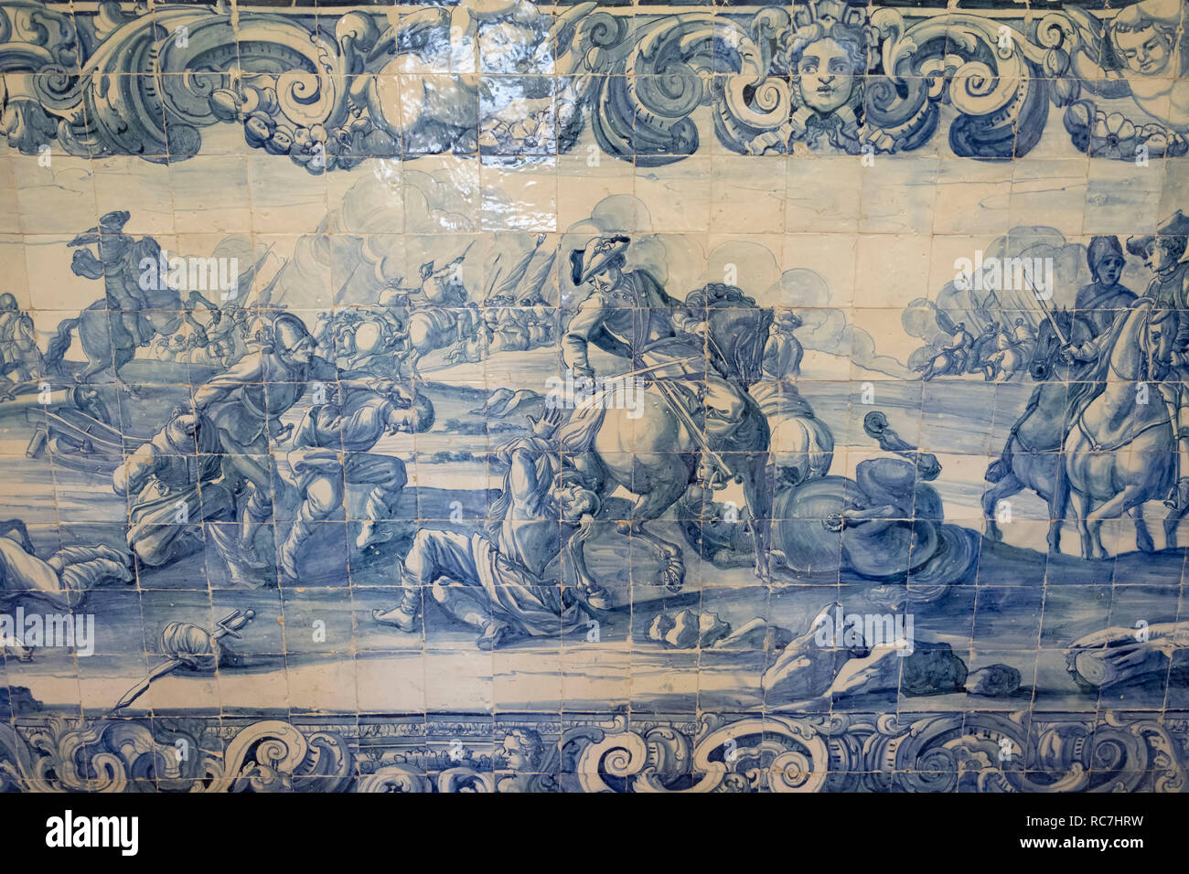 Traditional portuguese azulejos painted tiles depicting a battle scene at the Marques de Pombal Palace in Oeiras, Portugal, Europe - Stock Image
