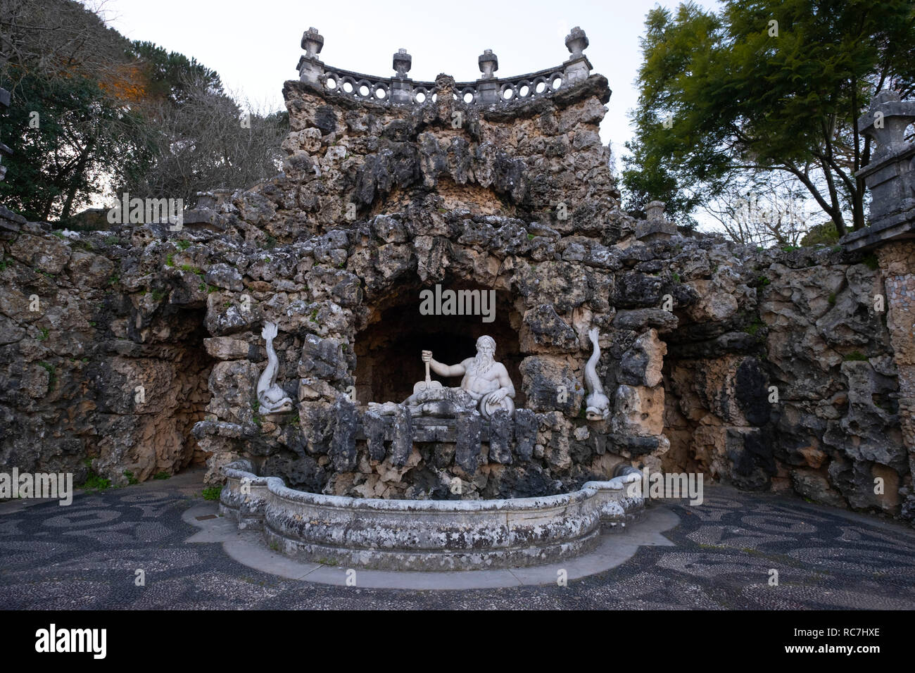Cascata dos Poetas - poets fountain with a statue of the god of the seas Poseidon at the Marques de Pombal Palace in Oeiras, Portugal, Europe - Stock Image